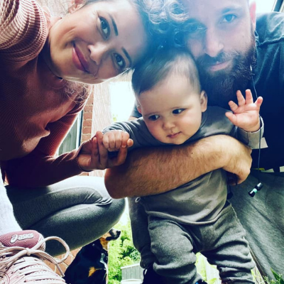 Couple crouching with baby